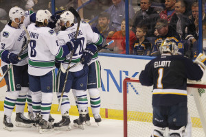 St. Louis Blues goaltender Brian Elliott collects his thoughts as Vancouver Canucks players celebrate a Radim Vrbata goal in the third period at the Scottrade Center in St. Louis on March 30, 2015. Vancouver won the game 4-1. Photo by Bill Greenblatt/UPI