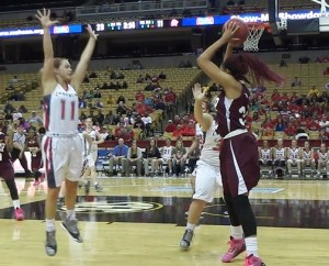 Central pressures Cardinals Ritters Romekia Wallace after a long rebound in the second half