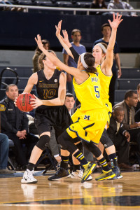 Maddie Stock (10) is guarded heavily by two Michigan defenders. (photo/Michigan Athletics)