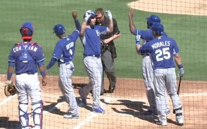 Eric Hosmer is greeted at home plate after hitting a first inning home run.