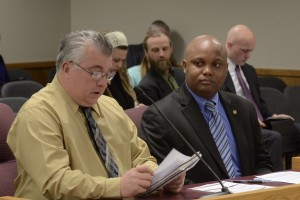Representative Shamed Dogan (right) listens as Michael Mizanskey reads a statement in support of Dogan's bill that seeks to free Jeff Mizanskey, who is serving life in Missouri prison for non-violent marijuana offenses.  (photo courtesy; Tim Bommel, Missouri House Communications)
