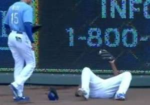 Lorenzo Cain shows the ball after crashing into the wall making a catch in right center field.
