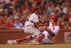 St. Louis Cardinals Peter Bourjos slides safely at home past the tag of Philadelphia Phillies catcher Carlos Ruiz  in the fifth inning at Busch Stadium in St. Louis on April 29, 2015.  Photo by Bill Greenblatt/UPI