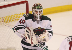 Minnesota Wild goaltender Devan Dubnyk keeps an eye on a flying puck in the first period against the St. Louis Blues of Game Five of the Stanley Cup Western Conference Quarterfinals at the Scottrade Center in St. Louis on April 24, 2015. Minnesota won the game 4-1.   Photo by Bill Greenblatt/UPI