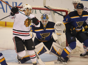 Chicago Blackhawks Kris Versteeg tries to block the view of St. Louis Blues goaltender Jake Allen in the first period at the Scottrade Center in St. Louis on April 9, 2015.   Photo by Bill Greenblatt/UPI