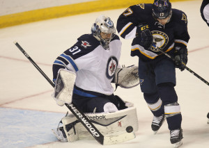 Winnipeg Jets goaltender Ondrej Pavelec of the Czech Republic denies St. Louis Blues Jaden Schwartz shot on goal in the first period at the Scottrade Center in St. Louis on April 7, 2015. Photo by Bill Greenblatt/UPI