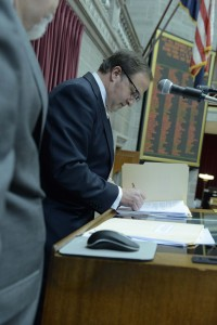 House Speaker John Diehl, Junior, signs the budget bills after the House and Senate finished voting on them.  (photo courtesy; Tim Bommel, Missouri House Communications)