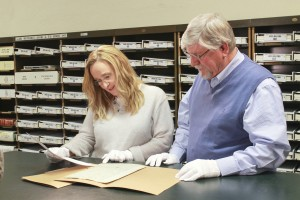 Melissa Etheridge looks over her ancestor's original will with local historian Robert J. Mueller. (Photo courtesy of TLC)
