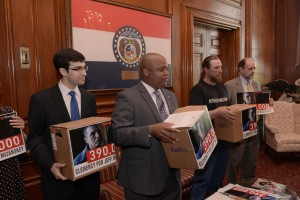 Representative Shamed Dogan (center) and Chris Mizanskey (to Dogan's left) deliver a petition to Governor Nixon asking for an early release for Chris' father Jeff Mizanskey, who is serving life in prison under a sentencing law that Missouri has since taken off the books.  (Photo courtesy; Tim Bommel, Missouri House Communications)