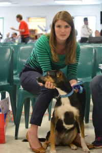 Jan was the 3,000th dog to be adopted from the program.  Jan sits with her new owner Amelia Blanton.  (Photo courtesy of David Owen)