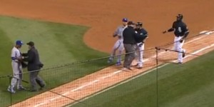 Yordano Ventura (L) and Adam Eaton (R) are held back by umpires before benches clear.