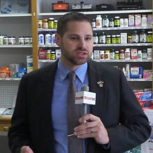 State Representative Kurt Bahr explains the NPLEx system at Whaley's Drugstore in Jefferson City.