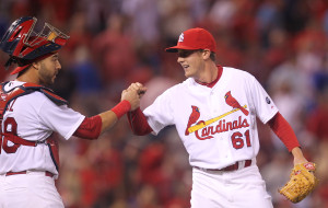 St. Louis Cardinals pitcher Seth Maness and cathcer Tony Cruz celebrate the third out and a 10-9 win over the Chicago Cubs at Busch Stadium in St. Louis on May 4, 2015.  Photo by Bill Greenblatt/UPI