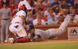 Chicago Cubs Chris Coghlan dives for home plate in front of St. Louis Cardinals catch Yadier Molina in the fifth inning at Busch Stadium in St. Louis on May 6, 2015. Coghlan scored from second base on a double by Anthony Rizzo.    Photo by Bill Greenblatt/UPI