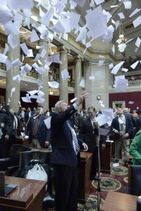Missouri state representatives continue the traditional paper toss to end the 2015 legislative session.  (photo courtesy; Tim Bommel, Missouri House of Representatives)