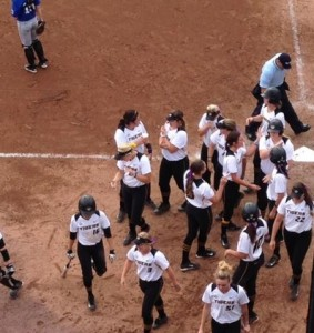 Teammates celebrate Jordan Zolman's home run