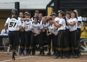 Sami Fagan is greeted at home after her first inning home run (photo/Mizzou Athletics)