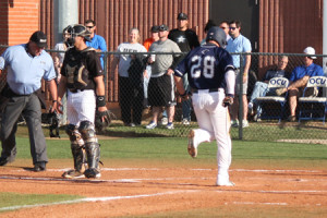 Jared Hagley crosses the plate in the second inning (Photo Courtesy Bill Meyers, MBUSpartans.com)