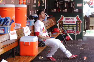 St. Louis Cardinals starting pitcher Tim Cooney sits alone in the dugout after coming out of the game in the fourth inning in his major league debut against the Philadelphia Phillies at Busch Stadium in St. Louis on April 30, 2015.  Photo by Bill Greenblatt/UPI