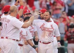 St. Louis Cardinals Jhonny Peralta is congratulated by teammates after hitting a solo home run in the tenth inning to defeat the Arizona Diamondbacks 3-2 at Busch Stadium in St. Louis on May 25, 2015. Photo by Bill Greenblatt/UPI