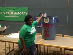 State workers threw away symbolic pay-raise vouchers into a trash can to show their objection of the zero percent pay increase for state workers in the 2016 budget.