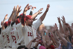 The Arkansas Razorbacks celebrate their 3-2 victory with their fans. (photo/Chase Snider-KTTS)