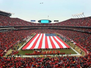 The U.S. Flag is displayed over the field at Arrowhead Stadium before a game between the Kansas City Chiefs and the Seattle Seahawks, November 16, 2014.  (courtesy; kchiefs.com)