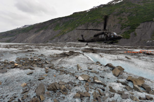 An Alaska National Guard Blackhawk Helicopter lands at the site of the wreckage of a C-124 cargo plane that crashed in 1952.  A joint military effort to recover remains and wreckage continues each year, during the roughly two-week window that weather and terrain allow access to the site.  (Photos courtesy; U.S. Air Force photos/Tech. Sgt. John S. Gordinier)