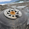 A wheel from the C-124 Globemaster; part of the wreckage that gradually is exposed as the Colony Glacier melts.  (Photos courtesy; U.S. Air Force photos/Tech. Sgt. John S. Gordinier)