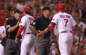 Home plate umpire Joe West (L) explains a call to St. Louis Cardinals manager Mike Matheny while first base umpire Kerwin Danley keeps Matt Holliday back after both were ejected in the seventh inning during a game against the Milwaukee Brewers at Busch Stadium in St. Louis on June 2, 2015. Photo by Bill Greenblatt/UPI