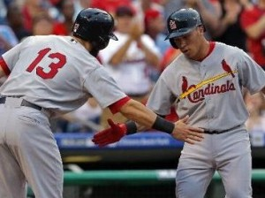 Kolten Wong is greeted at home plate by Matt Carpenter (photo/MLB)
