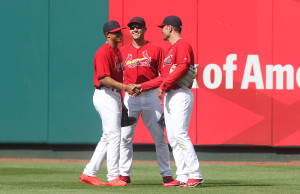 Newly signed St. Louis Cardinals outfielder Nick Plummer shakes hands with teammates Peter Bourjos and Jaime Garcia as he takes to the field before a game against the Minnesota Twins at Busch Stadium in St. Louis on June 15, 2015. MLB.com has confirmed that Plummer received a $2.1244 million bonus, which is equivalent to the slot value for the 23rd overall pick.   Photo by Bill Greenblatt/UPI