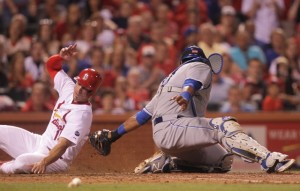 St. Louis Cardinals Randal Grichuk slides into home plate past the tag of Kansas City Royals catcher Salvador Perez on a sacrifice fly ball in the eighth inning at Busch Stadium in St. Louis on June 12, 2015. St. Louis won the game 4-0. Photo by Bill Greenblatt/UPI