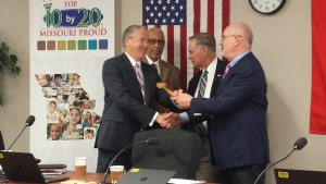 Former state representative and senator Charlie Shields of St. Joseph accepted the gavel from Peter Herschend of Branson, as he became President of the State Board of Education.
