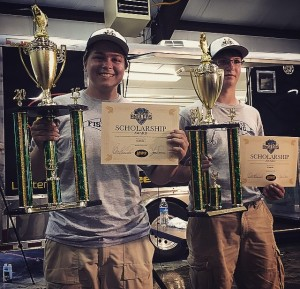 Hudsen Lee (L) and Trent Distler (R) show off their third place trophies following a recent two-day high school tournament on Stockton Lake
