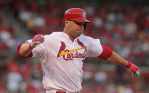 St. Louis Cardinals Matt Holliday pulls up as he touches first base in the first inning against the Cincinnati Reds at Busch Stadium in St. Louis on July 29, 2015.Holliday then left the game with a leg injury.    Photo by Bill Greenblatt/UPI