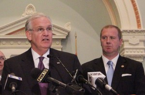 Governor Jay Nixon (left) signed the municipal court reform bill sponsored by Senator Eric Schmitt.  (Bill Greenblatt/UPI)