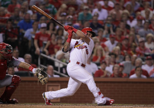 St. Louis Cardinals Kolten Wong swings, hitting a grand slam home run in the fourth inning against the Cincinnati Reds at Busch Stadium in St. Louis on July 27, 2015. St. Louis won the game 4-1. Photo by Bill Greenblatt/UPI