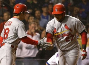 Jhonny Peralta is greeted at home plate by Pete Kozma following his home run (photo/MLB)