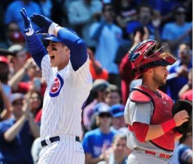 Anthony Rizzo celebrates his home run as Tony Cruz looks on (photo/MLB)