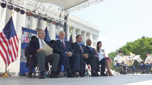 (from left) Former Missourinet news director and master of ceremonies Bob Priddy, Governor Jay Nixon, Senator Mike Kehoe, Missouri Supreme Court Judge George W. Draper III, and Jefferson City Mayor Carrie Tergin on the stage at the celebration of the 100th anniversary of the laying of the Missouri State Capitol cornerstone.