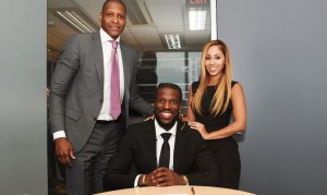 DeMarre Carroll signs with Toronto. (photo/Raptor.com)