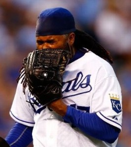 Johnny Cueto yells into his glove following a three-home night (photo/MLB)