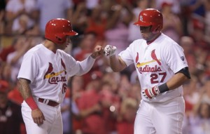 St. Louis Cardinals Kolten Wong (L) greets Jhonny Peralta after Peralta hit a two RBI home run in the sixth inning against the Colorado Rockies at Busch Stadium in St. Louis on July 31, 2015. Photo by Bill Greenblatt/UPI