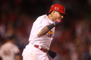 St. Louis Cardinals Yadier Molina pumps his fist as he runs the bases after hitting a solo home run in the eighth inning against the San Francisco Giants at Busch Stadium in St. Louis on August 19, 2015.    Photo by Bill Greenblatt/UPI
