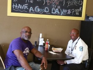 Interim Police Chief Andre Anderson, right, is a regular at the Burger Bar and More. Pictured with owner Charles Davis, left. Photo courtesy of Burger Bar and More.