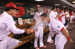 St. Louis Cardinals Matt Carpenter gets a cup full of water in the face from Carlos Martinez in the dugout after hitting a two run home run in the third inning against the Cincinnati Reds at Busch Stadium in St. Louis on September 23, 2015. The home run was Carpenter's second two run homer of the night.       Photo by Bill Greenblatt/UPI