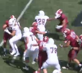 Calen Crowder stiff arms a Chadron State defender during the Bears home opener
