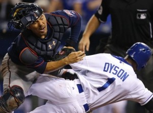 Jarrod Dyson is called out at home plate by umpire Greg Gibson after colliding with Minnesota's Kurt Suzuki in the tenth inning (photo/MLB)