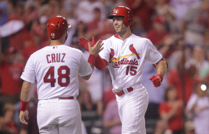 St. Louis Cardinals Randal Grichuk (15) is congratulated by Tony Cruz as he touches home plate after hitting a two run home run in the seventh inning against the Chicago Cubs at Busch Stadium in St. Louis on September 8, 2015. Photo by Bill Greenblatt/UPI